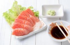 Salmon sashimi on white dish with Shoyu Sauce and wasabi Royalty Free Stock Image