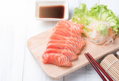 Salmon sashimi on wood block and white wood background, Japaness Royalty Free Stock Photos