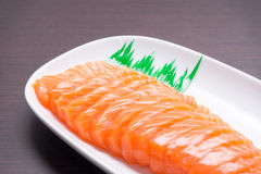 Salmon sashimi with wood texture 1 Royalty Free Stock Image