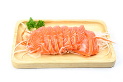 Salmon sashimi on a wooden plate. Isolated on white background Royalty Free Stock Images