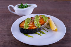 Salmon with sauce chimichurri Stock Photography