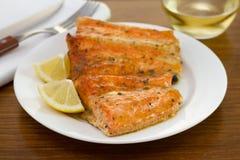 Salmon in sauce with lemon Stock Photo