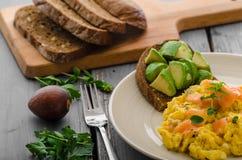 Salmon scrambled eggs and avocado toast Stock Photos