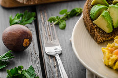 Salmon scrambled eggs and avocado toast Royalty Free Stock Photos