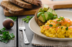 Salmon scrambled eggs and avocado toast Stock Image