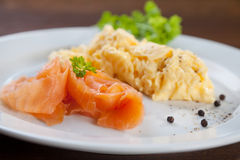 Salmon and scrambled eggs Royalty Free Stock Photography