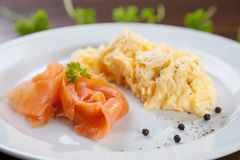 Salmon and scrambled eggs Royalty Free Stock Photo