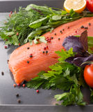 Salmon with seasoning on a pan Royalty Free Stock Photo