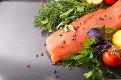 Salmon with seasoning on a pan Royalty Free Stock Photography
