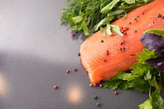 Salmon with seasoning on a pan Royalty Free Stock Image