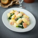 Salmon served with gnocchi and basil Royalty Free Stock Photo
