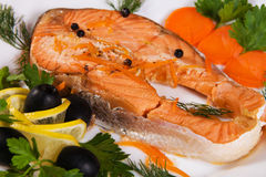 Salmon served with olives and lemon Royalty Free Stock Image