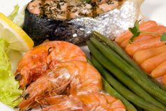 Salmon and Shrimp 5. A gourmet salmon and shrimp Dinner with vegetables Stock Image