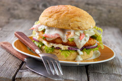 Salmon and shrimp burger Royalty Free Stock Photography