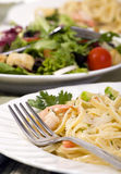 Salmon and Shrimp Fettuccine. Fresh fettuccine pasta with shrimp and smoked salmon Royalty Free Stock Image