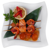 Salmon and shrimp skewer Stock Images