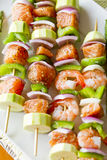 Salmon and Shrimp Skwers Prepped for BBQ. Salmon cubes and Shrimp complimented with vegetables on skewers. Ready to cook. Red onions, zuccini and green peppers Royalty Free Stock Photography