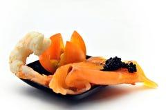 Salmon, shrimp and tomato Stock Images