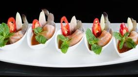 Salmon and shrimps with fish sauce Stock Photos