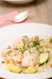 Salmon with shrimps, zucchini and noodles Stock Image