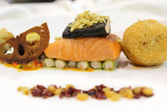 Salmon with side dishes on plate Royalty Free Stock Photos
