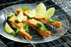 Salmon skewers Stock Image