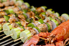 Salmon Skewers and Lobster Stock Photo