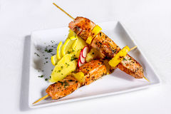 Salmon skewers with spices and lemon Stock Image