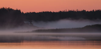Salmon Sky and Foggy Water Stock Images