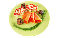 Salmon slice with mash on green Stock Images