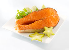 Salmon slice on a plate. And white background stock photography