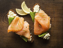 Salmon. Slice of smoked salmon with bread on wooden background royalty free stock photo