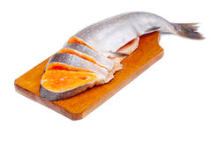 Salmon sliced on  cutting board. Isolated ower white background Royalty Free Stock Image