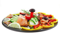 Salmon slices on black plate Stock Photo