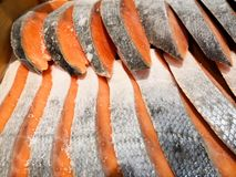 Salmon slices cut into thin slices and laid out on top of each other. Fresh beautiful fish. royalty free stock images