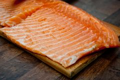 Salmon slices fried in a frying pan in sauce.  Royalty Free Stock Image