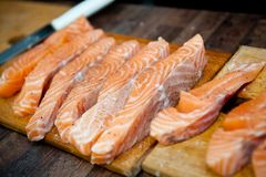 Salmon slices fried in a frying pan in sauce stock photo