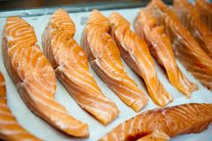 Salmon slices fried in a frying pan in sauce.  Royalty Free Stock Photography