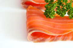 Salmon slices with parsley on  white. Salmon slices with parsley on white. Close up Stock Photography