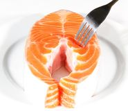 Salmon Slices pricked with a fork Royalty Free Stock Photo