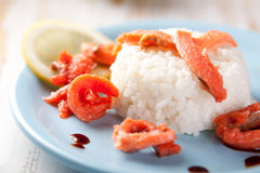 Salmon slices with rice. Lemon and soy sauce Royalty Free Stock Photo