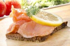 Salmon slices on rye bread Stock Image