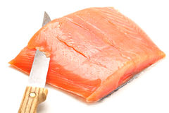 Salmon slicing with knife Royalty Free Stock Photography