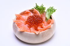 Salmon slide and salmon roe on wooden bowl white background Royalty Free Stock Image