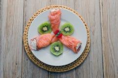 Salmon. Smoked salmon stuffed with cream cheese, garnished with avocado Royalty Free Stock Photo
