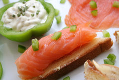 Salmon snack. A breakfast of fresh salmon and some bread Royalty Free Stock Photo