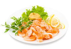 Salmon snack, clipping path. Cut salmon served with lemon and mustard Stock Photography