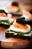 Salmon Snack with Egg and Caviar Royalty Free Stock Image