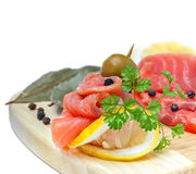 Salmon snack on the wooden board Stock Photos