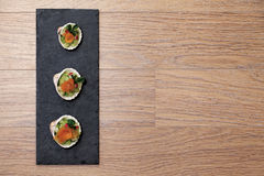 Salmon snacks in shells Stock Image